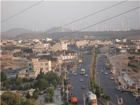 A view of modern Manjil; the wind power generators are seen in the background