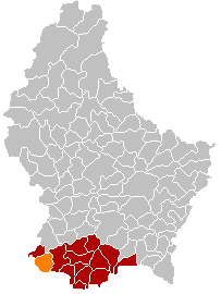 Map of Luxembourg with Differdange highlighted in orange, the district in dark grey, and the canton in dark red