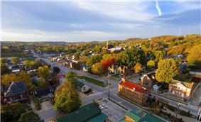 Early morning sun lights up the fall colors down Market Street in Hermann, Missouri