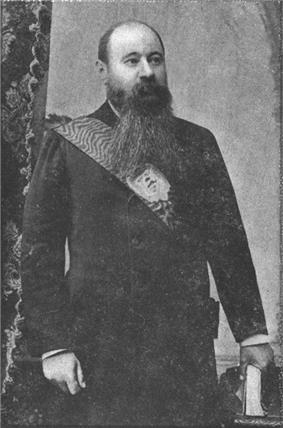A man with an enormous dark beard wearing a sash of state