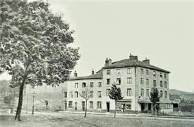 exterior of large house in rural 19th century France
