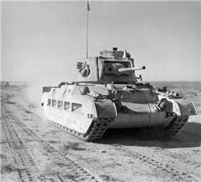 A tank moves across the desert