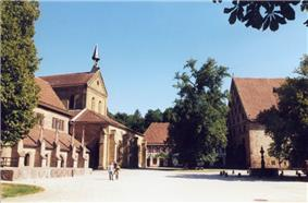 Monastery courtyard with the gothic church on the left and monastery buildings on the right