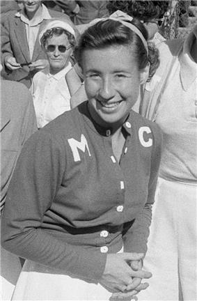 A woman looking and smiling toward the camera