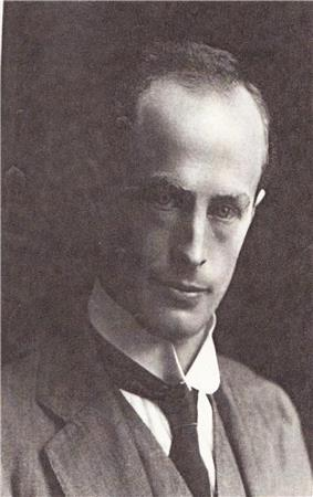Man wearing a tie, waistcoat and jacket.