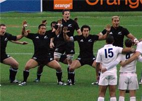 McCaw in the middle of the New Zealand haka facing a line of the French team in white