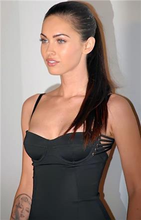 Megan Fox wearing a grey and lavender spaghetti strap dress