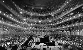 interior of huge 19th century opera house looking from the stage towards the audience seats