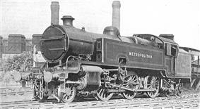 A black-and-white photograph of a 2-6-4 tank locomotive in three-quarter view. The side tank closest to the camera has the word