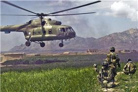 ISAF forces pull security for the safety of the pilots and team of an Mil Mi-17 helicopter as it leaves the Gulistan district in 2009.