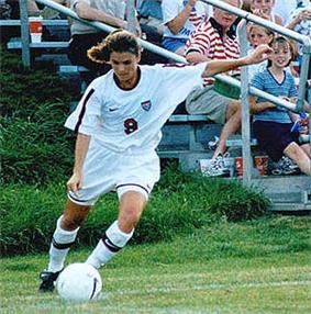 Mia Hamm takes corner kick.