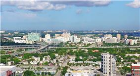 View westward of Civic Center, with the Midtown Interchange foreground and Miami International Airport right-background
