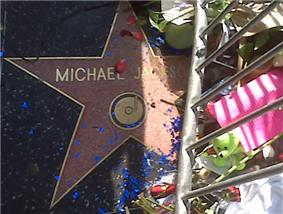 Jackson's star on The Hollywood Walk of Fame, showing flowers for fans to express grief.