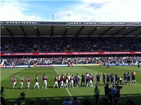 Millwall and West Ham players before kick-off in a game in August 2009