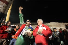 Luis Urzúa, the leader of the trapped miners and the last of the 33 to be lifted to freedom, celebrates with President Piñera at San José Mine, during