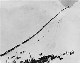 Miners climbing the Chilkoot Pass in 1898