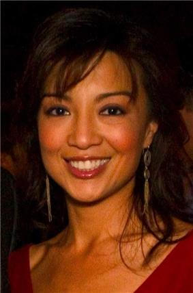 Asian woman smiling to the camera