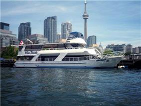 Miss Toronto Cruise Ship along the Toronto Harbour shoreline.