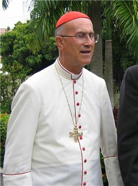Tarcisio Cardinal Bertone in dress for hot tropical countries (white cassock with scarlet piping and buttons).