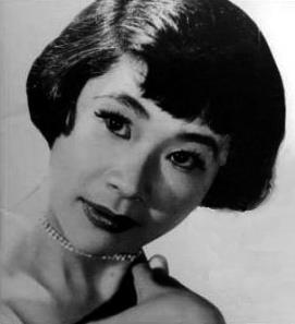 Glamorous headshot of a young Umeki, wearing a diamond necklace