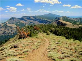 The summit trail and surrounding mountains.