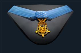 Gold medal, an inverted five-pointed star surmounted by an eagle, hanging from a formal blue ribbon in a display