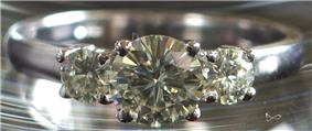 A round sparkling, clear gemstone with many facets.