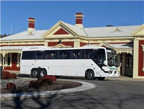 Photo of an Austral Denning 'Majestic' bodied Volvo B12R (13.5 m) owned by Moreland Buslines leaving Wagga Wagga Railway Station operating the dual Greyhound Australia/Firefly Melbourne to Sydney service, 2009.