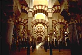 Inside of a mosque, with archways and pillars