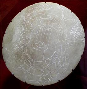 A stone palette from the Moundville Site, the back is concave and was used as a bowl for mixing paint