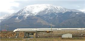 The Shinkansen streaks past Mt. Ibuki before reaching Maibara Station.