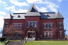 The Gothic Revival Municipal Center (1884), built as Brattleboro's High School, served the town in that capacity until 1951