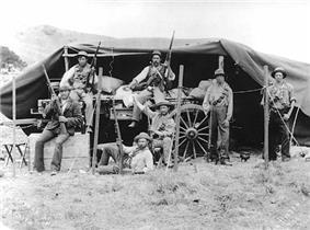 B&W photo of Boers on an ammunition wagon under a tarpaulin