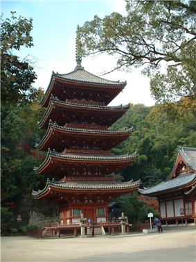 Five-storied pagoda with white walls and red beams.