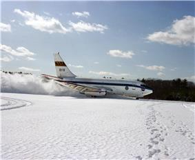 NASA 515 during braking test run on snow-covered runway at Brunswick Naval Air Station.
