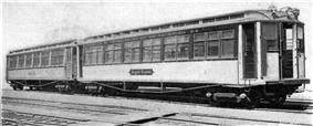 A photo of IRT Composite Prototypes. This photo is in black and white, and shows two wooden railcars, built circa 1902, on some railroad tracks.