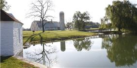 Nallin Farm Springhouse and Bank Barn