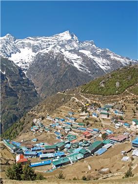 Namche Bazaar with Kongde Ri peak in the background.