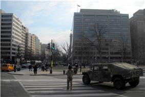 Military personnel and vehicle in the street
