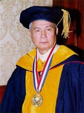 Angel Alcala, national scientist, is seen wearing deep blue and yellow academic gown with cap, deep blue with gold tassel.