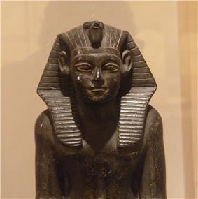 Statue of Neferhotep I from the Faiyum, Archaeological Museum of Bologna.S. Pernigotti: ''La statuaria egiziana nel Museo Civico Archeologico di Bologna'', Bologna 1980, 29–30, pl.27–29.