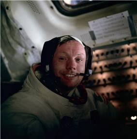 Photo of Armstrong smiling in his spacesuit
