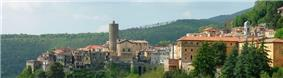 A panoramic profile of the historical architecture of Nemi, situated on the side of a wooden hill, taken in 2006