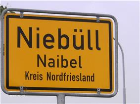 Bilingual sign in North Frisia (Germany) with the German name above and the North Frisian name below