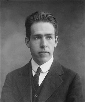 Head and shoulders of young man in a suit and tie