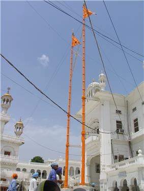 Nishan Sahib flags on tall poles over Harmandir Sahib in India