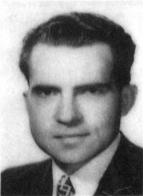 ID photo of a young man wearing a suit and tie