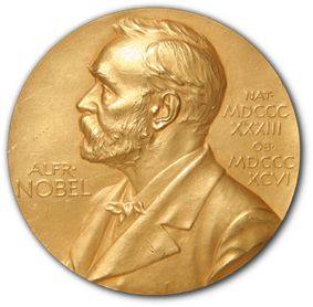 A golden medallion with an embossed image of Alfred Nobel facing left in profile. To the left of the man is the text