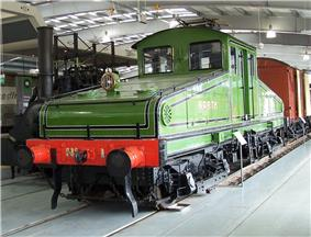 Old green electric locomotive in a museum