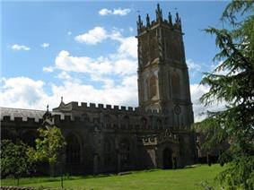 Stone building with prominent square tower.